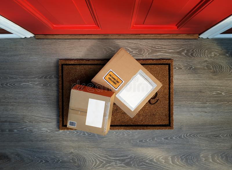 Boxes delivered to the door, easy to steal. Overhead view. Add your own copy to the labels stock image