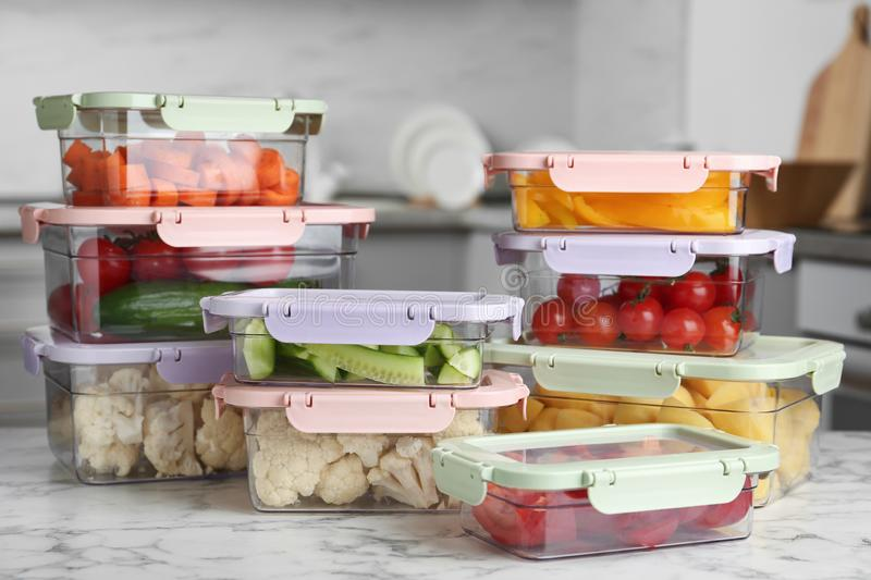 Boxes with fresh raw vegetables on table. In kitchen stock photo