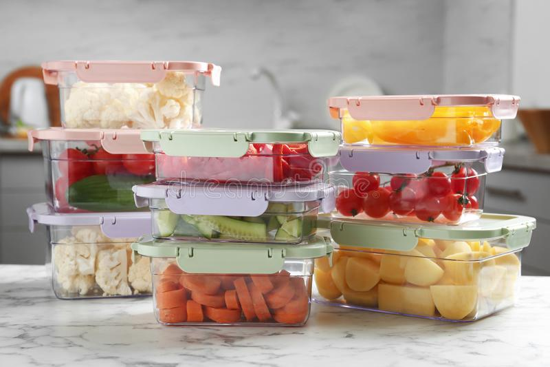 Boxes with fresh raw vegetables on table. In kitchen royalty free stock photography