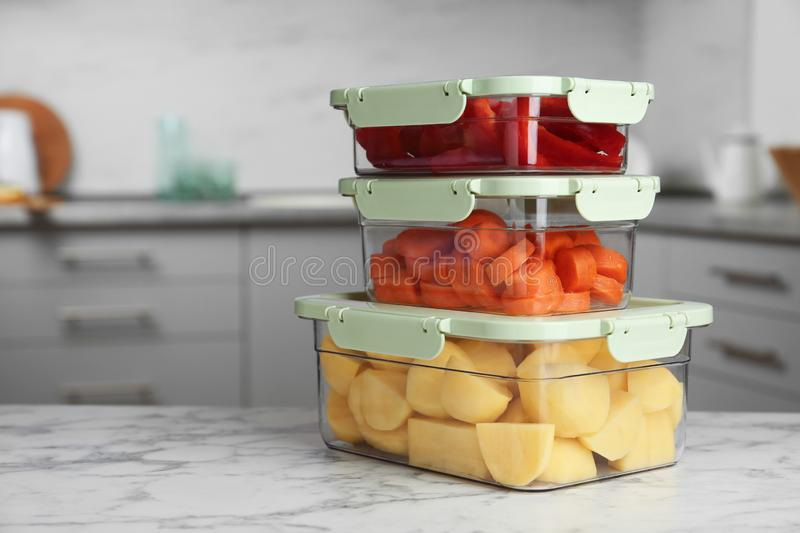 Boxes with fresh raw vegetables on table in kitchen. Space for text royalty free stock images