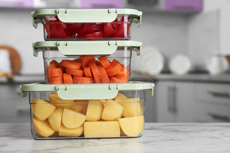 Boxes with fresh raw vegetables on table in kitchen. Space for text stock image