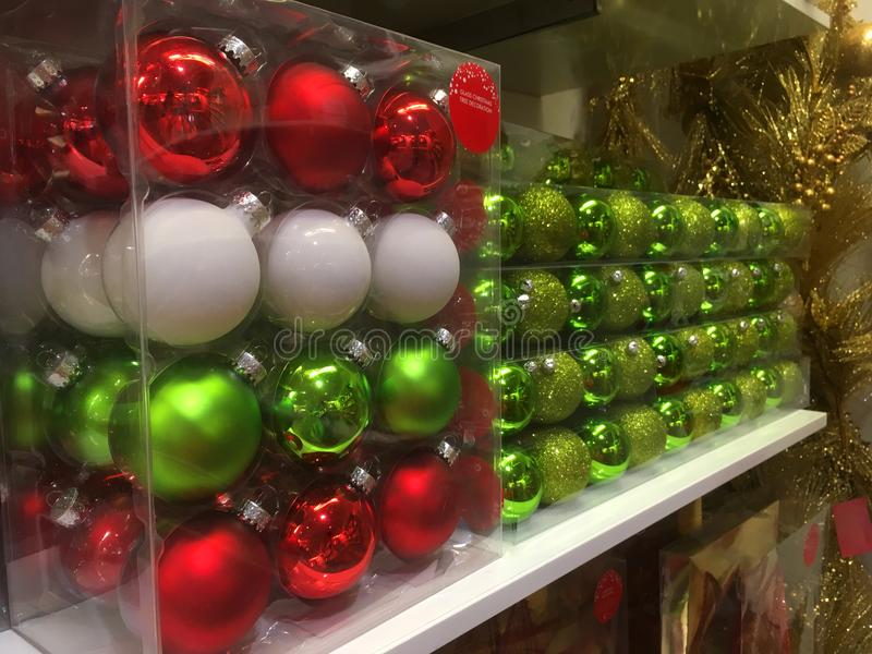 Boxes of Christmas tree baubles ready for purchase stock images