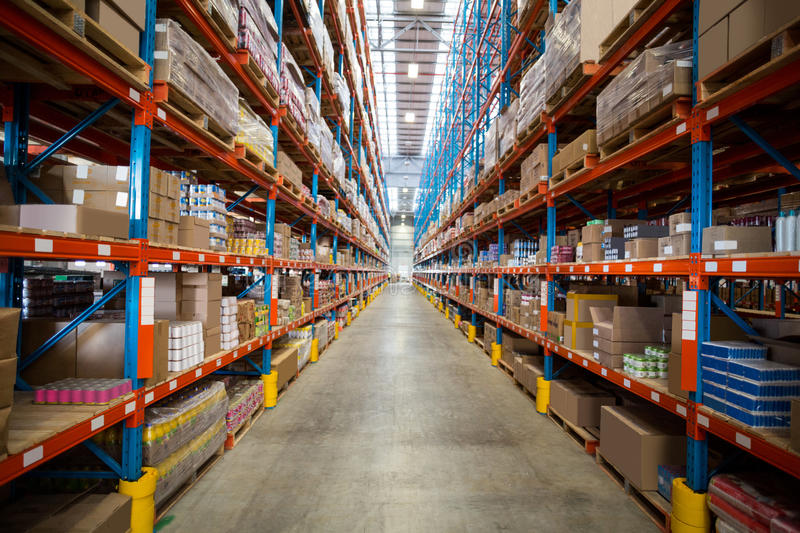 Boxes kept on shelves in the warehouse stock image