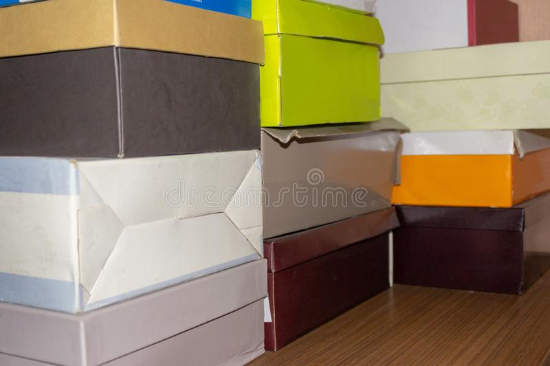 Boxes lie on the closet from under the shoes royalty free stock image