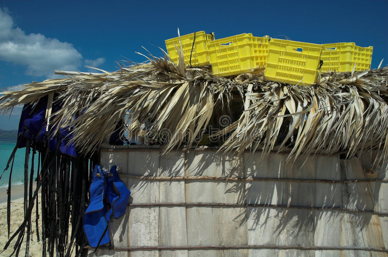 Boxes and life vests on top of a straw hut. In the caribbean stock photography