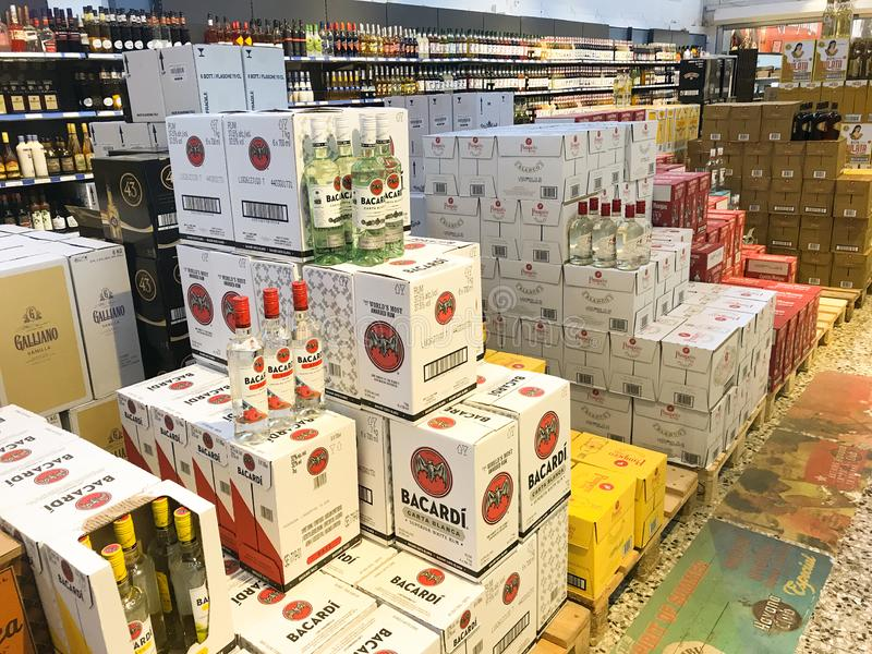 Boxes with liquor bottles stacked inside a wholesale supermarket. Copenhagen, Denmark - April 19, 2019 royalty free stock photography