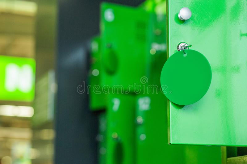 Boxes locks personal belongings market green style. Boxes with locks for personal belongings in the market in green style royalty free stock photography