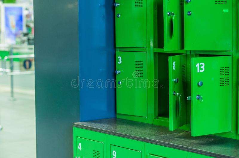 Boxes locks personal belongings market green style. Boxes with locks for personal belongings in the market in green style stock photography