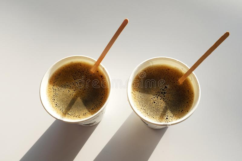 2 boxes of paper disposable cups without lid on the table in the cafe. Coffee to go with the sticks . Morning. Coffee for royalty free stock photo