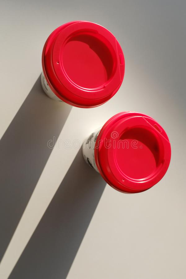 2 boxes of paper disposable cups with a red lid on the table in the cafe. Coffee to go. Morning. Coffee for Breakfast. 2 cups of royalty free stock images