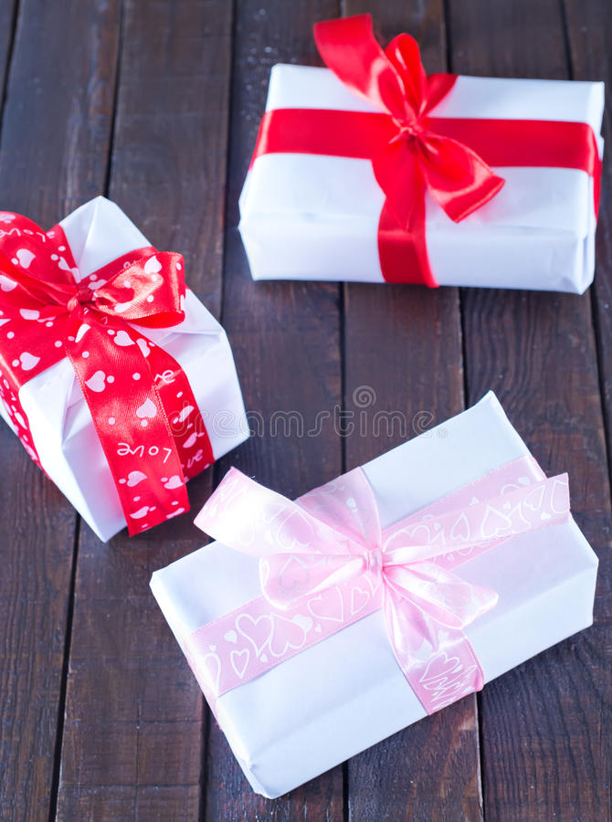Boxes for present. With ribbon on a table stock photo