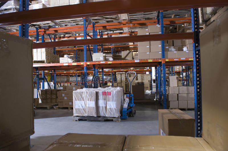 Boxes On Shelves In Warehouse. Cardboard boxes on shelves in distribution warehouse stock images