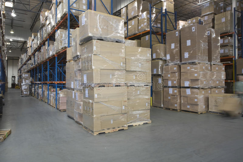 Boxes Stacked In Warehouse royalty free stock images