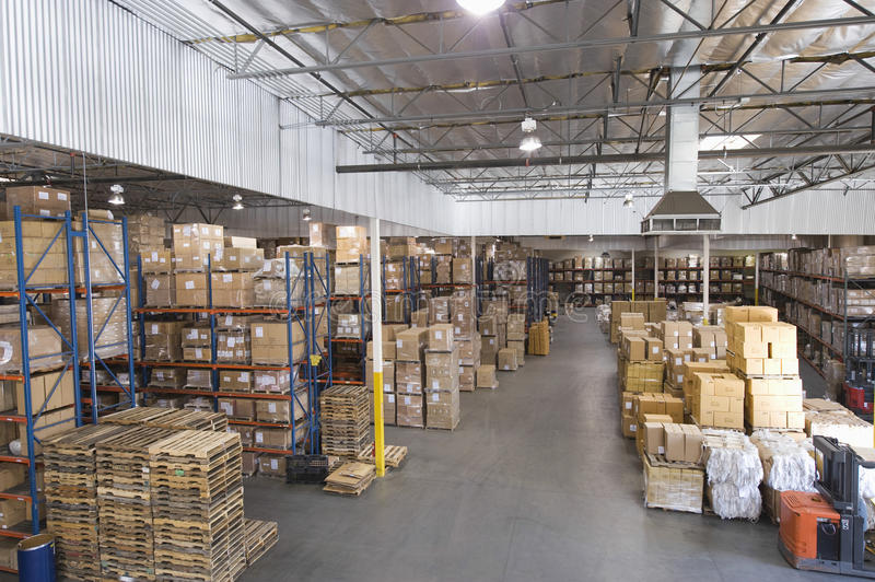 Boxes Stacked In Warehouse stock photography