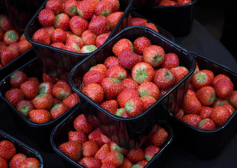 Boxes of strawberries sell in the market royalty free stock images