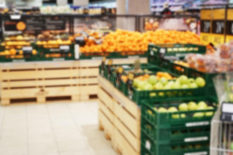 Boxes with various fresh fruits and vegetables in market royalty free stock photos