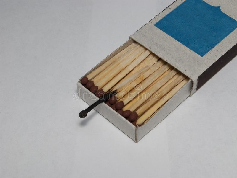 Boxes with whole matches and one burnt match. royalty free stock image