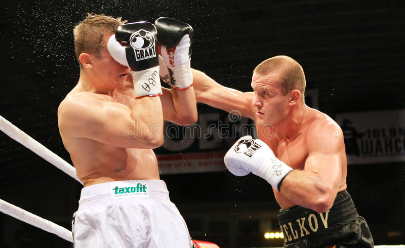 Boxing. WBA Intercontinental light heavyweight champion. Vyacheslav Uzelkov (18-0, 11 KO) (R) fights with Berlin-based Slovenian Denis Simcic (19-0, 10 KO) for stock photography