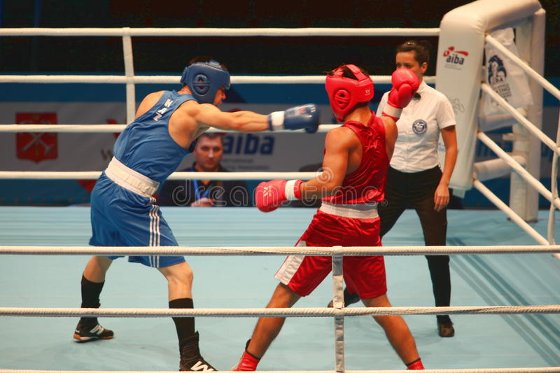 Boxing attack. St. Petersburg, Russia, November 21, 2016 AIBA Youth World Boxing Championships men heavy 81 kg. Boxing match between: RED- Tursunov C stock photography