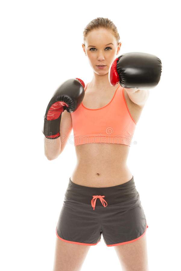 Boxing. Beautiful young isolated woman with sporty outfit and boxing gloves royalty free stock images
