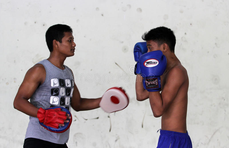Boxing. Children and adolescents practicing boxing at a gym in the city of Solo, Central Java, Indonesia royalty free stock photography