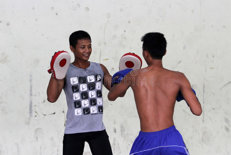 Boxing. Children and adolescents practicing boxing at a gym in the city of Solo, Central Java, Indonesia stock photos