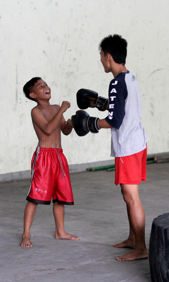 Boxing. Children and adolescents practicing boxing at a gym in the city of Solo, Central Java, Indonesia stock photo