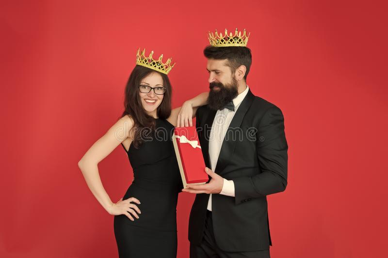 Boxing day. Bearded man and happy woman in crown. couple in love. date. business look. anniversary party gift box. Boxing day. Bearded men and happy women in royalty free stock image