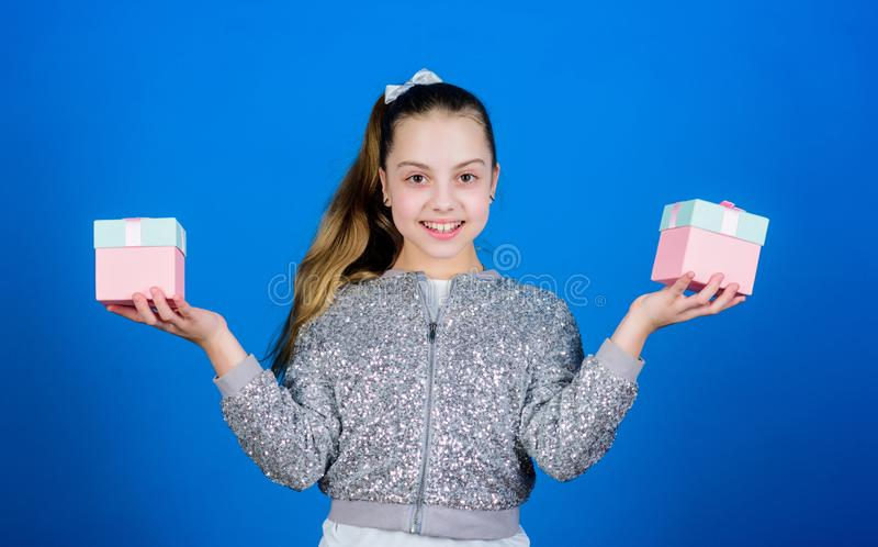 Boxing day. Christmas shopping. Cheerful child. Little girl with gift. Happy birthday. Holiday celebration. Surprise. Childrens day. Congratulation. Small girl stock photo