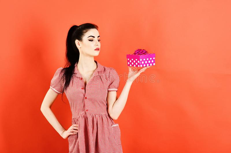 Boxing day concept. Woman holds bright pink gift pack at Boxing day stock photography