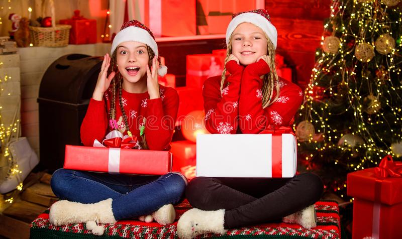 Boxing day. Happy holidays. Fun and cheer. Children cheerful christmas eve. Christmas gifts concept. Sisterhood. Sharing. Gifts. Sharing ability. Bring up stock image