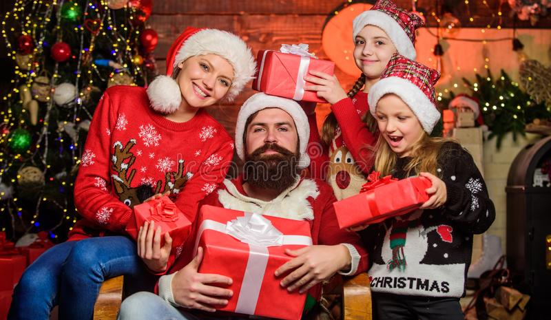 Boxing day. Happy holidays. Parents and children opening christmas gifts. Spend time with your family. Christmas. Tradition. Father bearded men and mother with stock photography