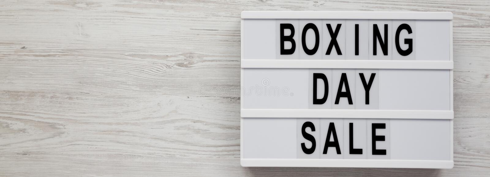 `Boxing day sale` words on a modern board on a white wooden background, top view. Overhead, from above, flat lay.  royalty free stock photo