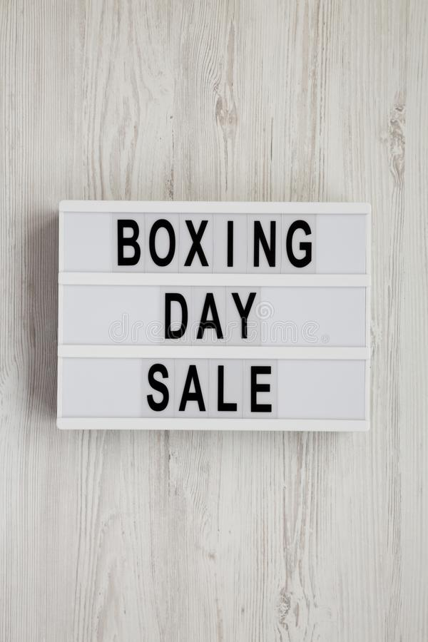 `Boxing day sale` words on a modern board on a white wooden background, top view. Overhead, from above, flat lay.  royalty free stock images