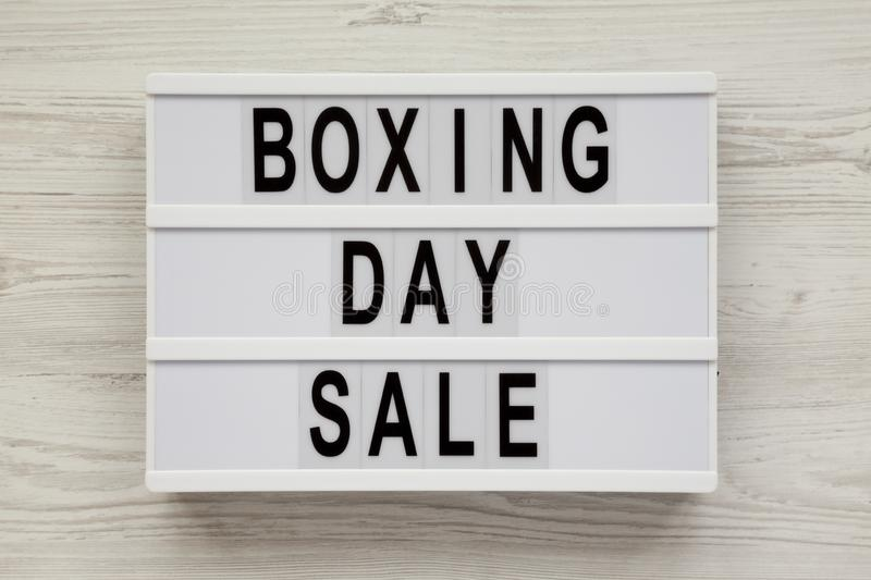 `Boxing day sale` words on a modern board on a white wooden surface, top view. Overhead, from above, flat lay.  stock image