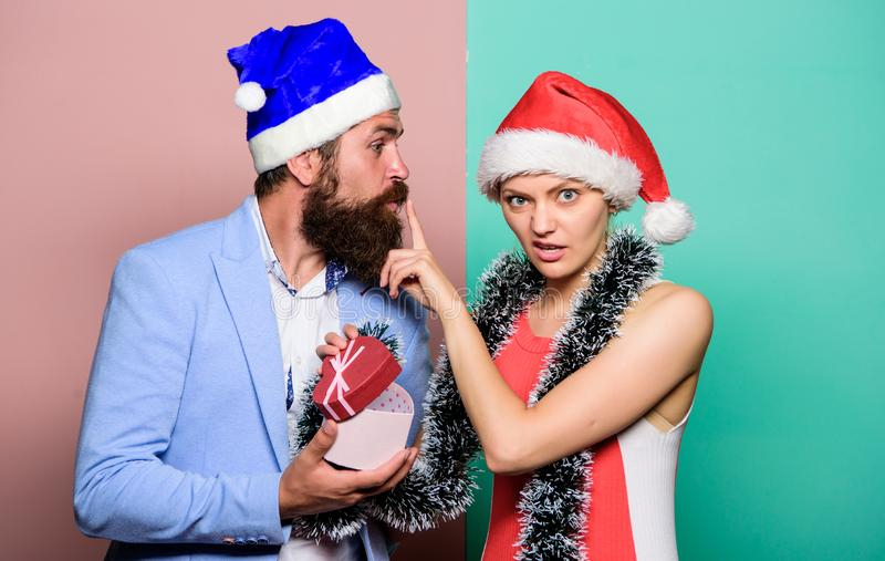 Boxing day. Secret Santa. Winter corporate party. Office christmas party. Happy man and woman wear santa hats. Cheerful stock photography