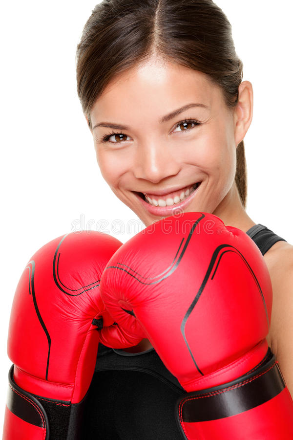 Boxing fitness woman. Boxer woman. Boxing fitness woman smiling happy wearing red boxing gloves. Portrait of sporty fit Asian Caucasian model on white background stock photo