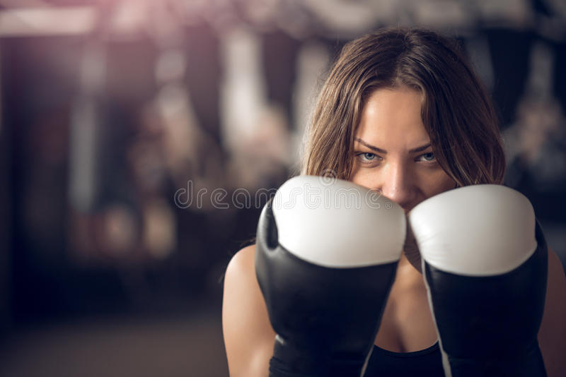Boxing girl posing with gloves. Young adult boxing girl posing with gloves stock image