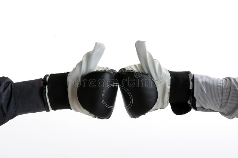 Boxing gloves. Bussinesman showing yes sign with boxing gloves stock photography