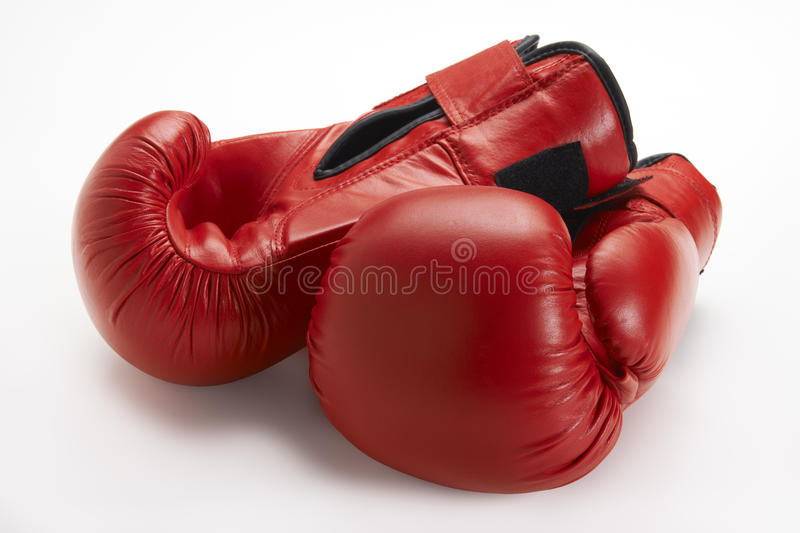 Boxing Gloves. Pair of red boxing gloves on white background royalty free stock photography