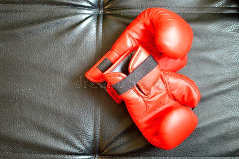 Boxing gloves on black background stock images