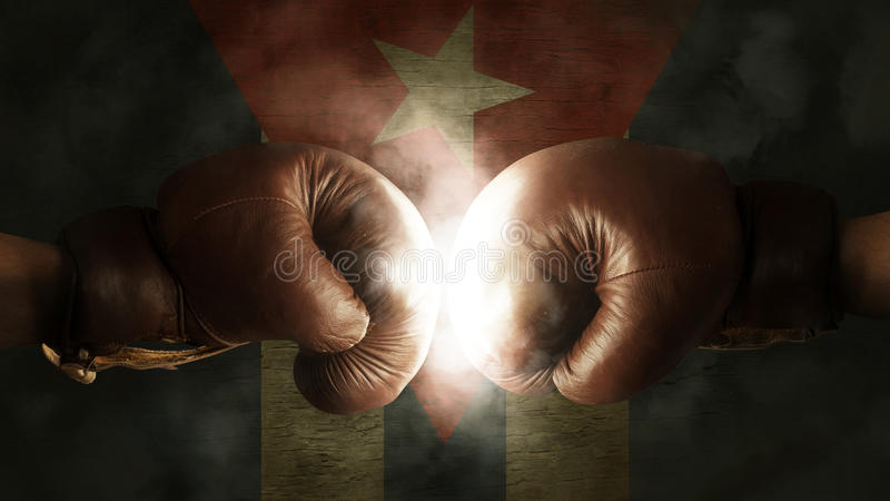 Boxing Gloves with the Flag of Cuba. Old Boxing Gloves with the Flag of Cuba stock photography