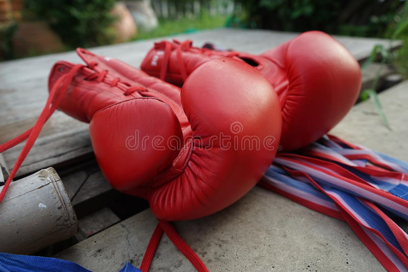 Boxing Gloves. Thai red boxing gloves on floor royalty free stock image