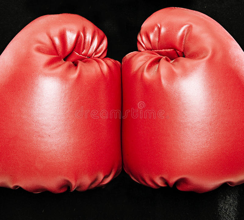 Boxing Gloves. Two Boxing gloves on a black background royalty free stock photography
