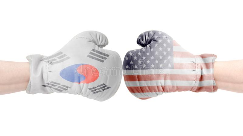 Boxing gloves with USA and South Korean Flag.USA vs South Korean concept. Isolated on a white background stock photo