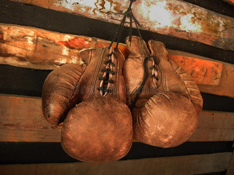 Boxing Gloves On The Wall. Old, Vintage Pair Of Leather Mittens royalty free stock image