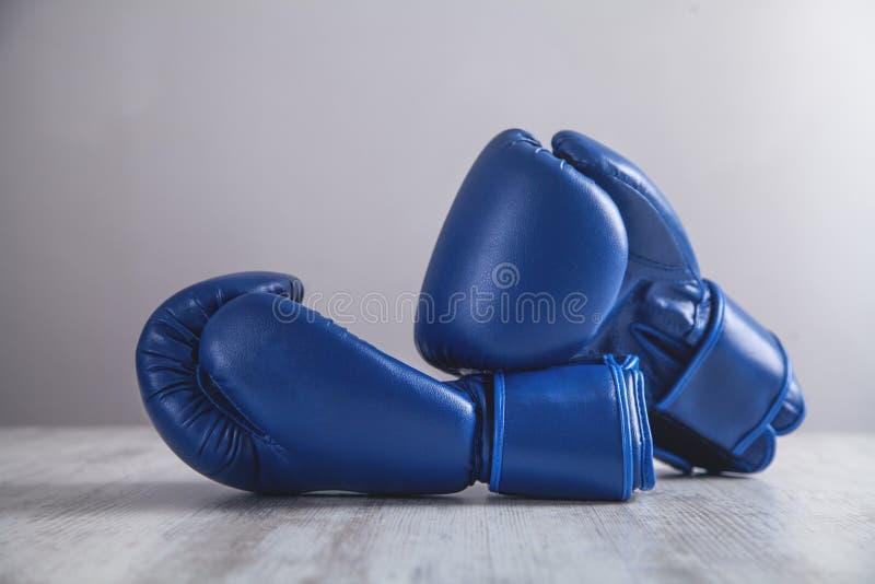 Boxing gloves on white modern desk stock photos