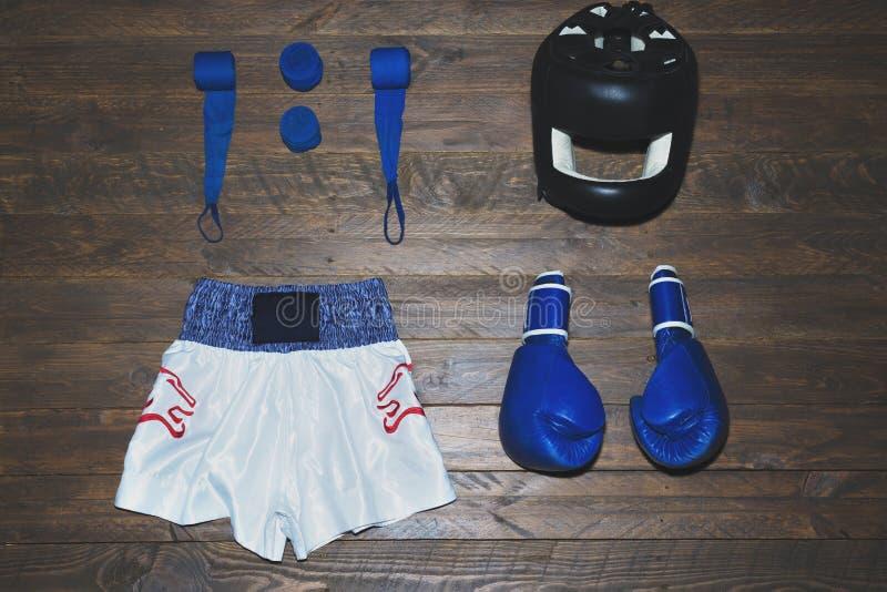 Boxing kit. Globes, helmet, boxing sales and boxing short stock photos