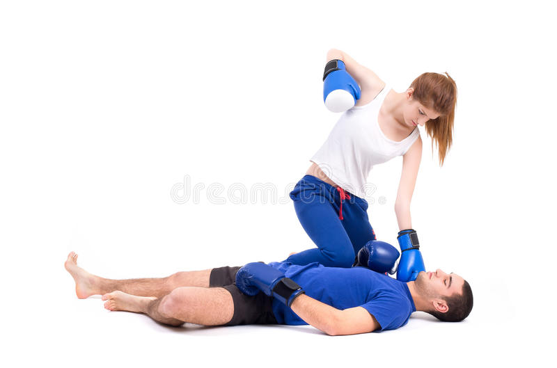 Boxing knockout. Girl knocked out man. Isolated on a white background. Studio shot royalty free stock images