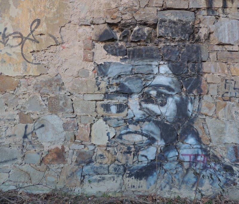 Boxing Legend Graffiti. Old wall graffiti reminding of a boxing legend Muhammad Ali stock photography
